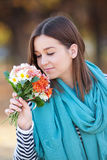 Young woman with bunch of wildflowers Royalty Free Stock Images
