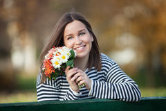 Young woman with bunch of wildflowers Stock Photos