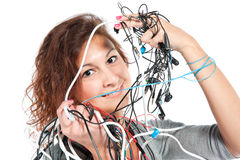 A young woman with the bunch of wires Royalty Free Stock Image