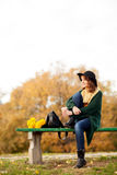 Young woman with bunch of yellow flowers Royalty Free Stock Photo