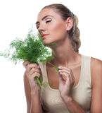 Young woman with  bundle herbs (dill) Stock Photos