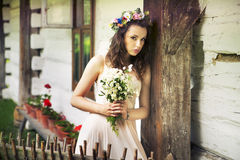 Young woman with buquet of wild flowers Royalty Free Stock Photos