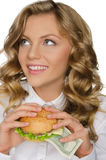 Young woman with burger of dollars looking away Stock Images