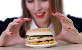 Young Woman and Burger Stock Photography