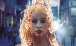 Young woman with burning hair Stock Images
