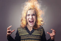 Young woman burning with rage Stock Image