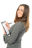 Young woman in business attire holding a planner/ Stock Images