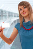 Young woman with business card Stock Photo