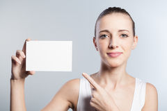 Young woman with business card. Young and beautiful woman with business card Stock Photos