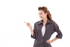 Young woman business executive pointing up something. Presenting on blank space Stock Photo
