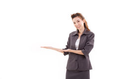 Young woman business executive pointing up something, presenting. On blank space Stock Image