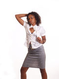 Young Woman in Business Outfit. Young Black woman in white top and grey skirt Stock Photo