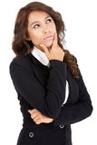 Young woman in business suit thinking Royalty Free Stock Photography