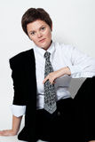 Young woman in a business suit. On a white background Stock Images