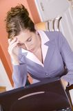 Young woman in business suit working from home Stock Photos