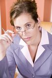 Young woman in business suit working from home Royalty Free Stock Photo