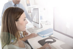 Young woman in business training. Woman in business training sitting in front of desktop stock images