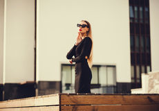 Young woman businessman stands near the building. copy space. Young woman businessman stands near the building in the city Stock Images