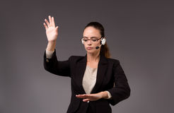 The young woman businesswoman pressing virtual buttons Stock Images