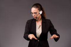 The young woman businesswoman pressing virtual buttons. Young woman businesswoman pressing virtual buttons Royalty Free Stock Photography