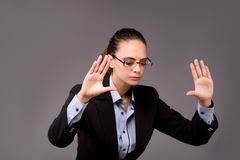 The young woman businesswoman pressing virtual buttons Stock Image