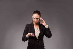 The young woman businesswoman pressing virtual buttons. Young woman businesswoman pressing virtual buttons Royalty Free Stock Photo
