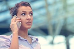 Young woman busy with calling, chatting on the cell phone side view portrait. stock images