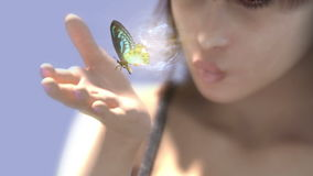 Young woman with butterfly stock footage