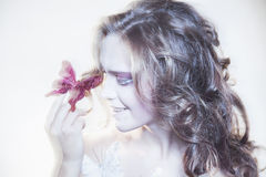 Young woman with butterfly Royalty Free Stock Images