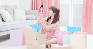 Woman buy shoes on internet. Young woman buy shoes on the internet and happy to receive the package royalty free stock photo