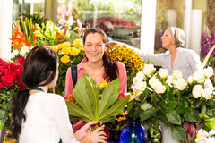 Young woman buying bouquet flower shop customer Royalty Free Stock Image