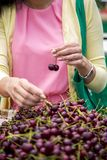 Young woman buying cherries Royalty Free Stock Images