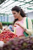 Young woman buying cherries Stock Photo