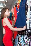 Young woman buying clothes in a boutique Stock Image