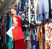 Young woman buying clothes in a boutique Royalty Free Stock Images