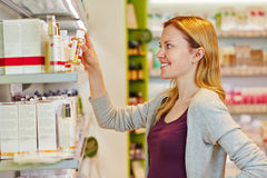 Young woman buying cosmetics Stock Image