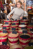 Young woman buying dried beans Royalty Free Stock Photos