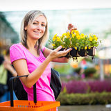 Young woman buying flowers Stock Image