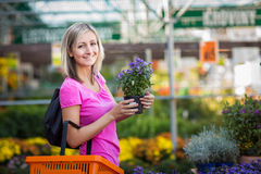 Young woman buying flowers Stock Photography