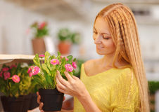 Young woman buying flowers at a garden center Stock Photography