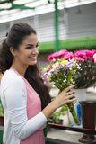 Young woman buying flowers Royalty Free Stock Photos