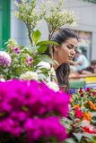 Young woman buying flowers Stock Photos