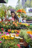 Young woman buying flowers Stock Photo