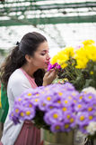 Young woman buying flowers Royalty Free Stock Images