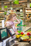 Young woman buying food at the grocery Royalty Free Stock Photography