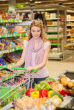Young woman buying food at the grocery Stock Images