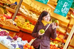 Young woman buying fresh fruits at market Stock Photography