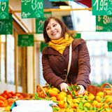 Young woman buying fresh fruits at market Stock Images
