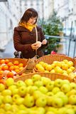 Young woman buying fresh fruits at market Stock Photo