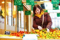 Young woman buying fresh fruits at market Royalty Free Stock Image